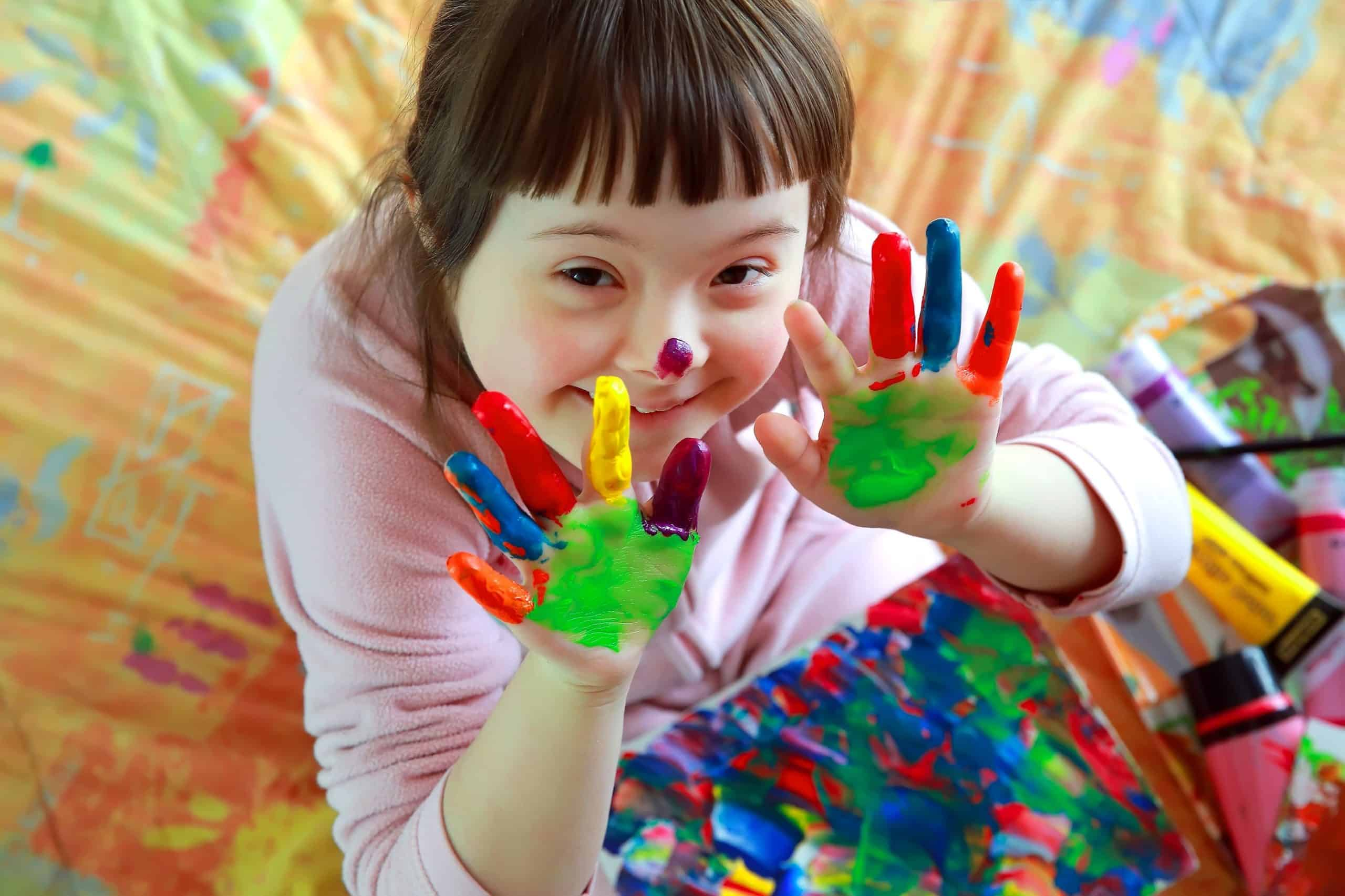 coloured-hands-girl-with-disability