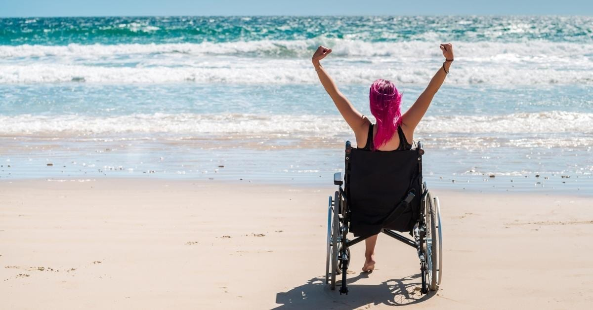disable woman at the beach