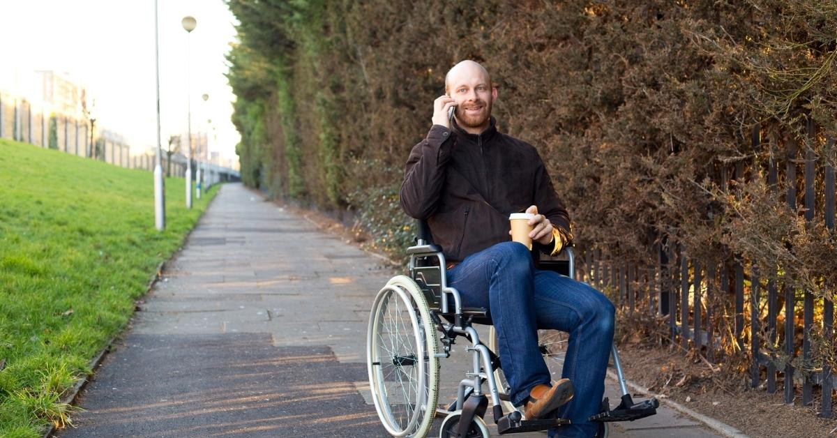 male-phone-wheelchair-disabled