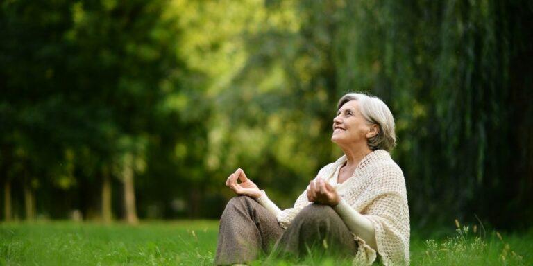 old lady meditation outside